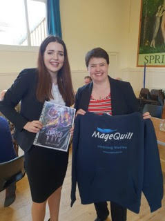 Highland student and author Kelsey McRae presenting Ruth Davidson MSP with a sweatshirt from Kelsey's publishers, the Dornie-based online publishing house MageQuill.  Kelsey's book, Indigo Rain, will be published later this year.